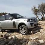 The Land Rover Range Rover LR V8 Supercharged easily scales rocks and any terrain, why not a man and a motorcycle?